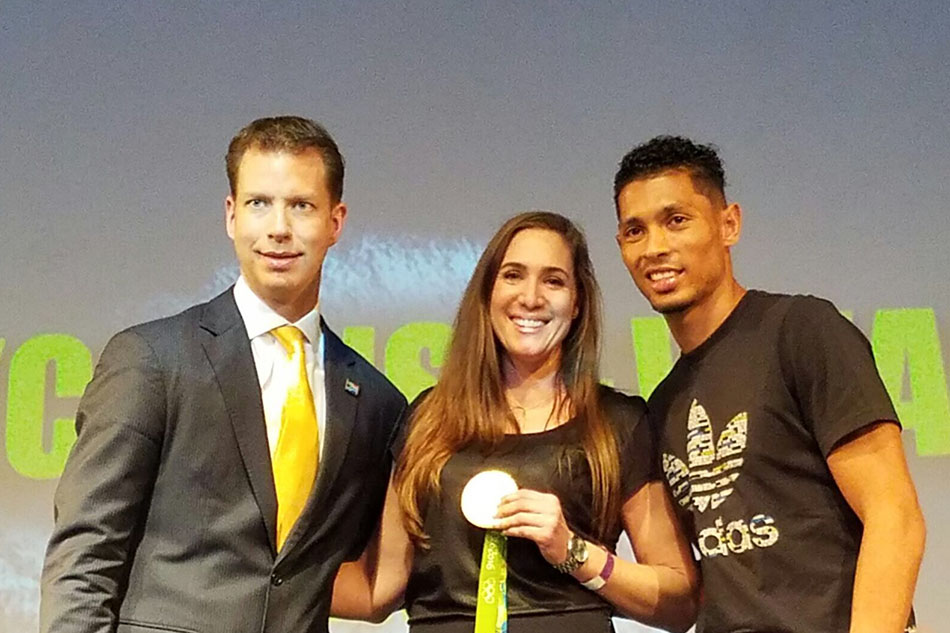 Holly with Olympic Gold Medalist Wayde van Niekerk