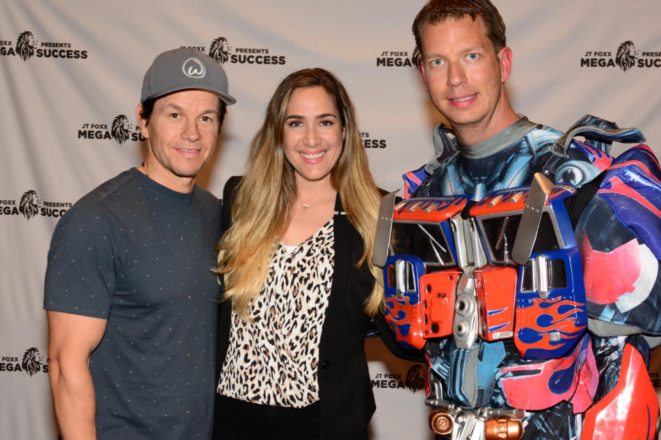 Holly with actor, producer, and businessman Mark Wahlberg