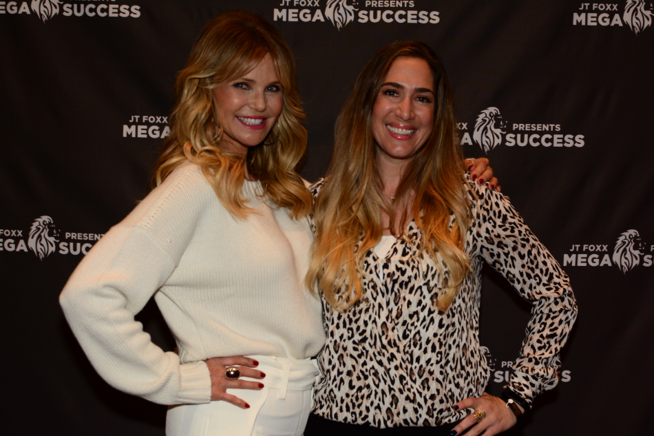 Holly with model and actress Christie Brinkley