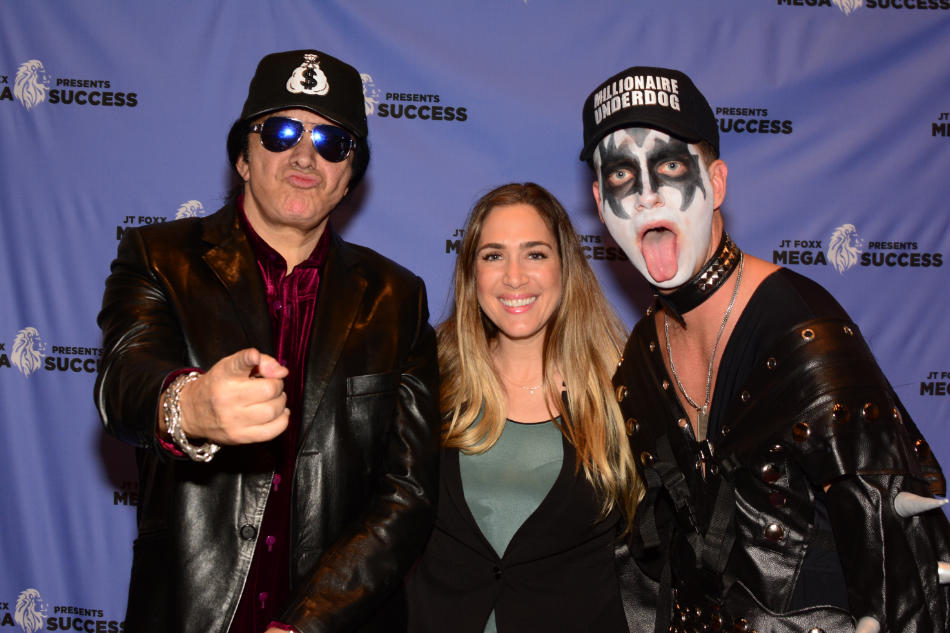 Holly with multi-talented musician Gene Simmons